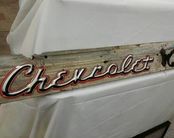 Chevrolet coat hook sign