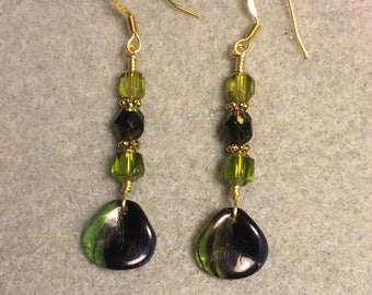 Green and purple Czech glass rose petal dangle earrings adorned with green and purple Czech glass beads.