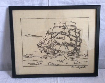 A framed vintage Embroidery of the Cutty Sark.
