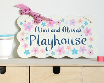 Playhouse or bedroom sign with blue hand painted personalisation, multicoloured flowers and pink ribbon with chocolate spots by Moobaacluck