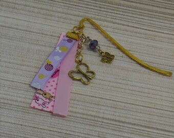 Bookmark in metal gilded with purple bead, butterflies and ribbons