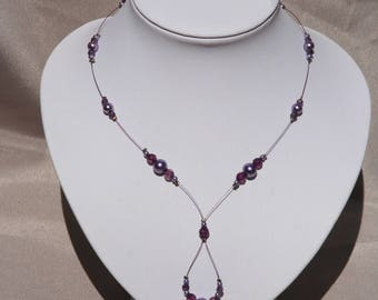 Purple necklace for wedding or ceremony