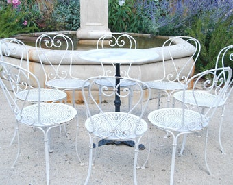 8 beautiful garden or conservatory wrought iron French vintage chairs. Unusual set of 8, very good vintage condition. Patina on white.