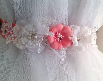 Pretty belt for the bride stripped satin coral color and decorated with white and coral flowers.