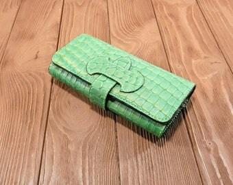 green reptile purse