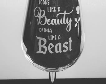 Looks like a beauty drinks like a beast Engraved Wine Glass - New
