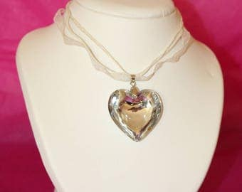 Beautiful glass pendant with silver heart