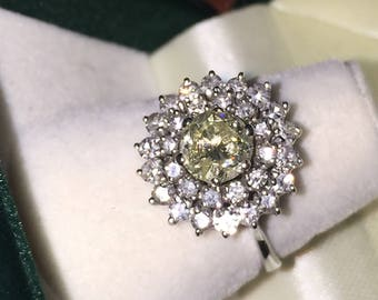Diamond Cluster Ring in 18K White Gold. Central stone is a Fancy Yellow Diamond of 0.84ct. Vintage circa 1954.