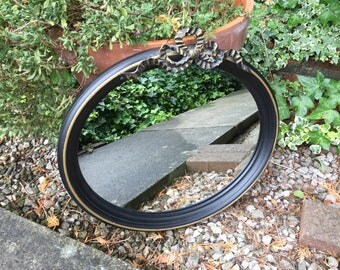 Black and Gold Trimmed Oval Mirror with stunning bow.
