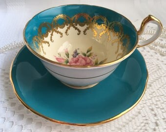 Aynsley Bone China Tea Cup and Saucer, Turquoise Blue with Pink Rose Centre, Gold Gilding and Trim