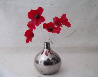 beautiful bouquet of five poppies with vase.