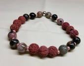 ESSENTIAL OIL DIFFUSING Lava bracelet. Stack/Wrap/Stretch. Rhodonite beads. Natural volcanic lava rock. Boho chic. Gaia ways.