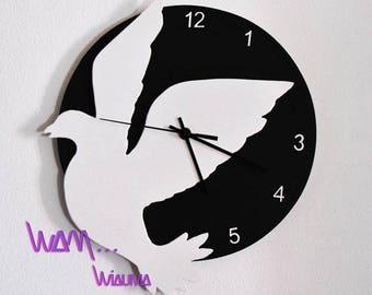clock white dove on black background