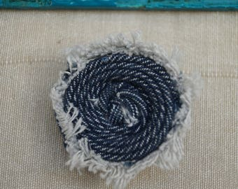 Brooch in rolled jeans