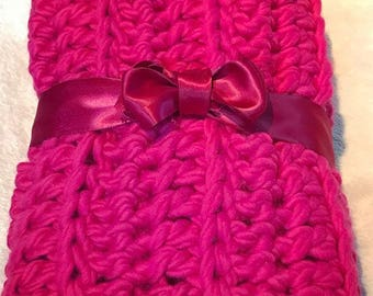 Raspberry colored crocheted blanket for baby