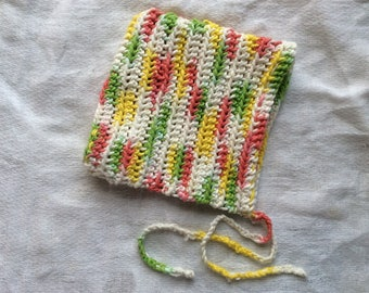 Crocheted baby bonnet. Cotton baby cap. Peaked baby hat.