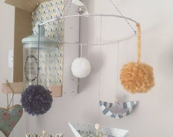 Origami boats mobile and pom poms wool for little boy blue mustard White Pearl wood and Bell