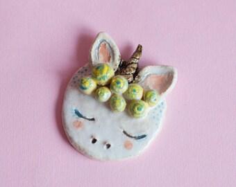 Ceramic unicorn head.