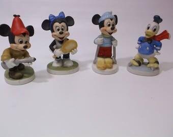 Disney Figurines Mickey Minnie Donald Duck Walt Disney Statue Lot of (4) Mickey the Hunter and Minnie Donald Duck and Mickey the Skier