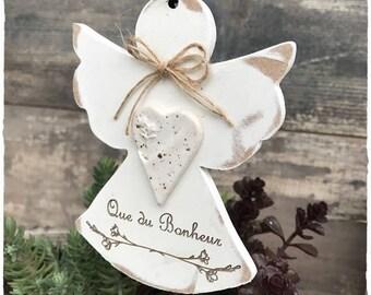 Angel made of white weathered wood with decorative ceramic iron stem