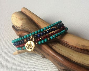 Turquoise, lapis, and glass beaded Om charm cuff memory wire bracelet