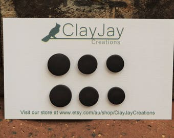 Black round polymer clay earrings