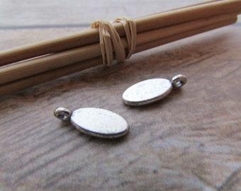 10 Breloque sequin goutte ovale 15 x 6 mm en métal argenté -  trou 1.5 mm - 543.22
