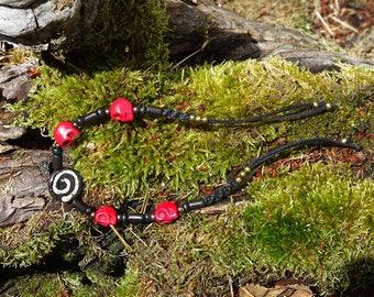 Spiral and skulls bracelet ~ handmade & OOAK *also available with green skulls!*