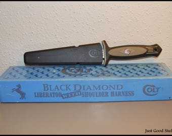 "Colt Black Diamond Stainless Steel Knife with Black Plastic Cover.  ""Black Diamond Liberator"" model CT8"