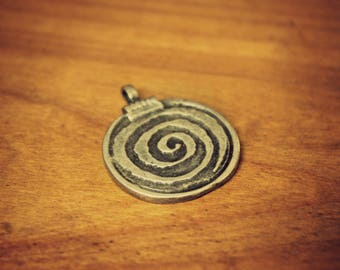 Ethnic pendant in silver plated brass