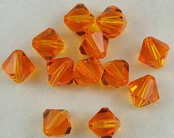 12 8mm Swarovski crystal bicone 5301 Sun beads 653