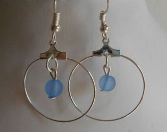 Mini hoops with their blue beaded heart