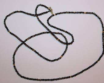 beaded necklace with gold spacers