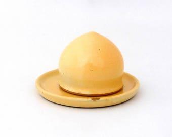 Magic salt shaker and little dish, yellow, stoneware