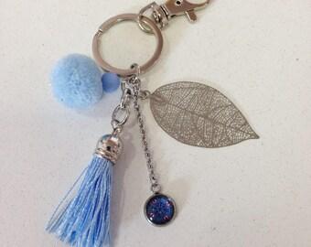 Light blue handbag with tassels, leaf and cabochon