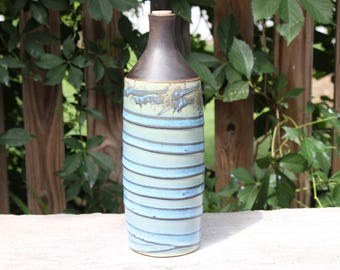 Blue wave bottle with black top