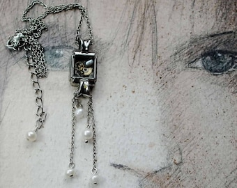 Steampunk Necklace-Pendant  wrist watch case with cogs in  resin, chain pompon, sweetwater  pearls silver colour chains