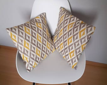 Pillow cover with geometric patterns in yellow mustard, beige and light brown