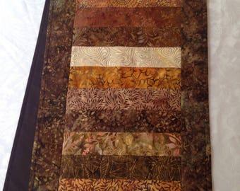 Brown, beige and gold batik table runner