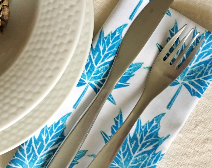 Set of four organic cotton dinner napkins, maple leaves in turquoise