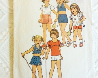 1970's Simplicity #6908, Girls Stretch Knit Top, Halter Top, Pantskirt, and Shorts Size 6 Breast 25