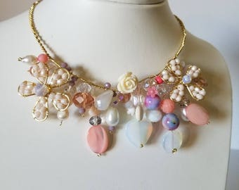 Cute bib with a variety of stones for a special occasion.