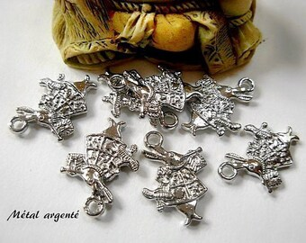 "Set of 6 ""White Rabbit"" charms in silver."