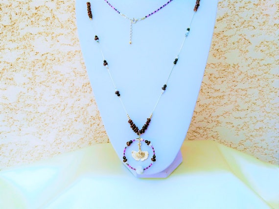 long necklace with a ginkgo pendant, semi-precious stones and seed beads