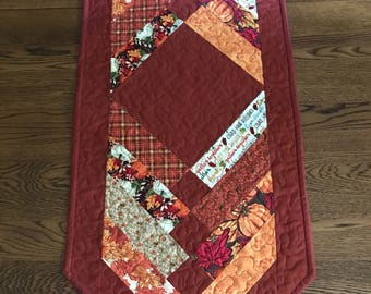 Thanksgiving quilted table runner, chevron shaped, rust, gold, orange, green and red