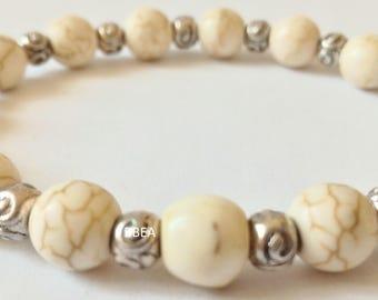 Bracelet magnesite 8 mm and Tibetan silver round beads