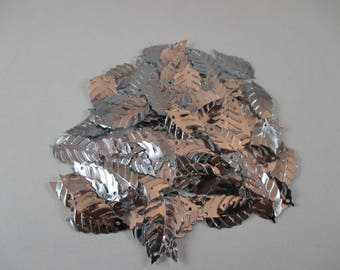 Sequin sewing, leaf, silver color.