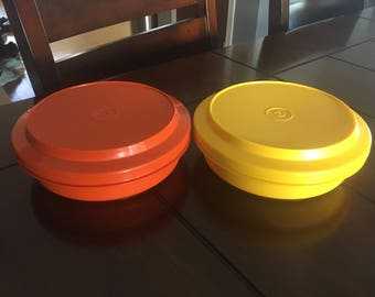 Two vintage tupperware covered plates