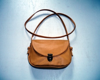 small bag in mustard yellow leather with buckle
