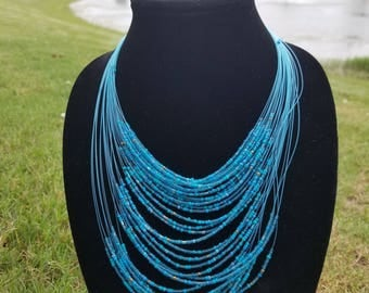 A Turquoise  Multiple Strand Maasai Necklace with Turquoise & Gold  beads